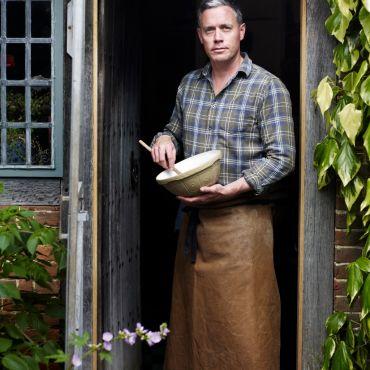 Aaron Bertelsen at door with bowl
