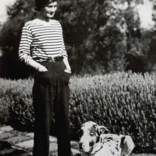 Chanel wearing a sailor's jersey and trousers 1928