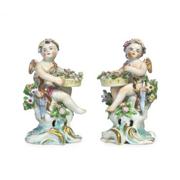 A1392-2017 mossgreen Lot 88 pair of Cheslea figures of cherubs